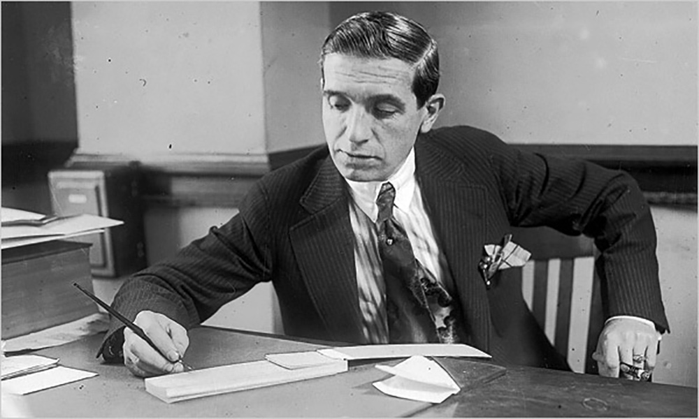 Charles Ponzi in 1920, while still working as a businessman in his office in Boston