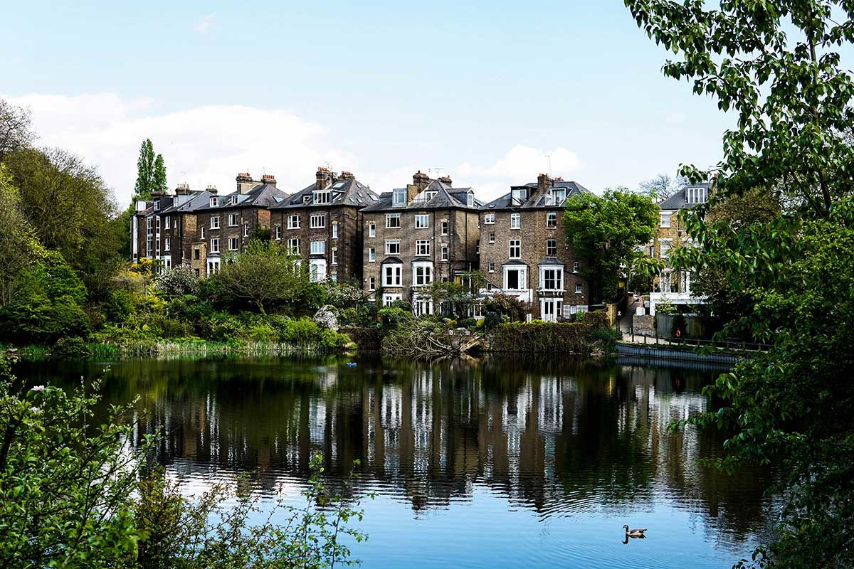 houses overlooking Hampstead Heath pond in London
