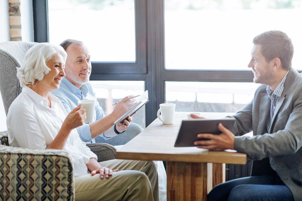 older couple meeting financial advisor for pension advice