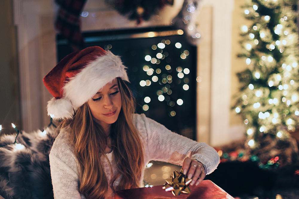 woman opening a Christmas present