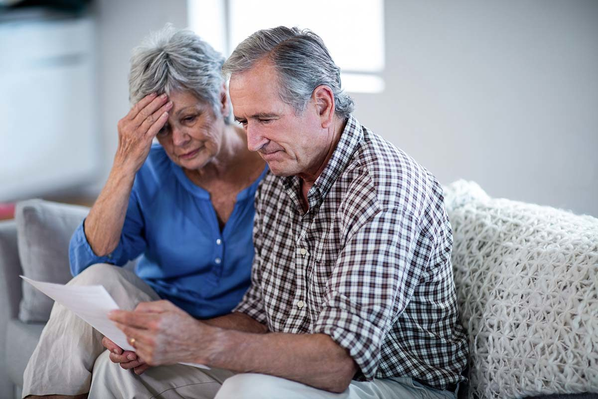 worried senior couple prisoners of bad mortgages
