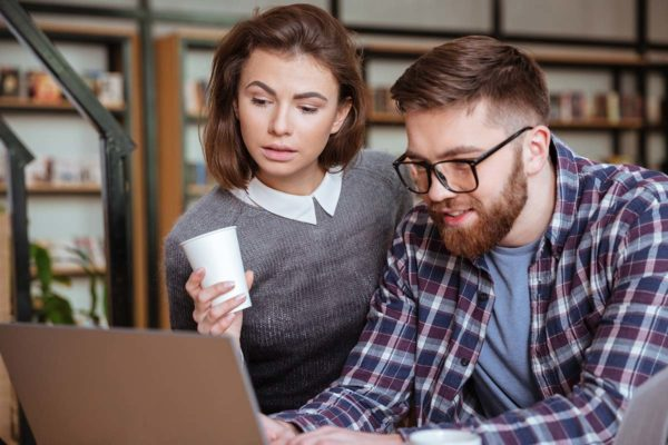 young couple searching online for a mortgage
